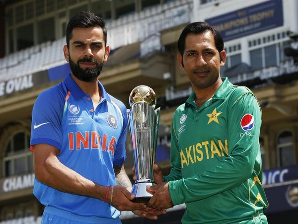 Pakistan's Sarfraz Ahmed and India's Virat Kohli pose with the trophy